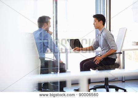 Two men working in a modern office