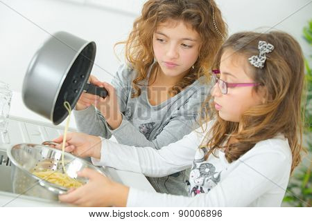 Two sisters cooking together
