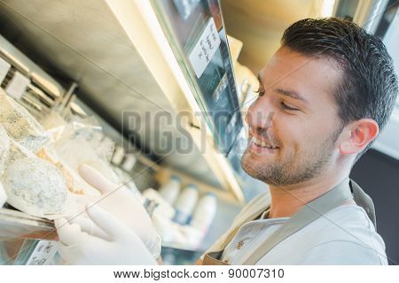 Gloved man at cold counter
