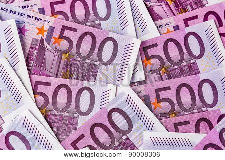 many five hundred euro banknotes are adjacent. symbolic photo for wealth and investment