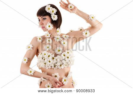 beautiful woman in inflorescences of chrysanthemums on the body