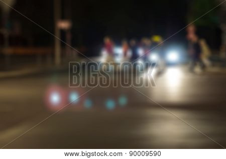 Blurry abstract cityscape night crosswalk with people