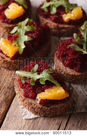 Sandwiches With Beetroot, Oranges And Rucola Close-up. Vertical