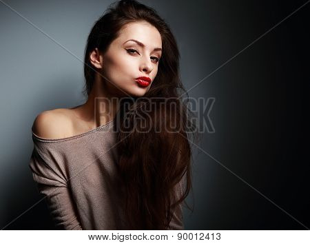 Sexy Grimacing Young Woman With Red Lipstick On Dark
