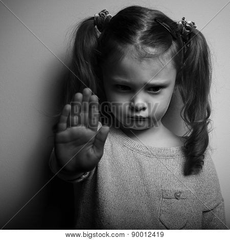Kid Girl Showing Hand Signaling To Stop Violence And Looking Down