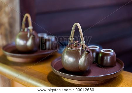 drinks, pottery and asian tradition concept - tea-set at asian teahouse
