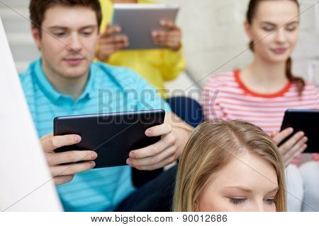 education, technology, people and internet concept - close up of students with tablet pc computers at school