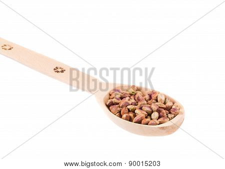 spoon with pistachios