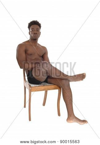African Man Sitting On Chair.