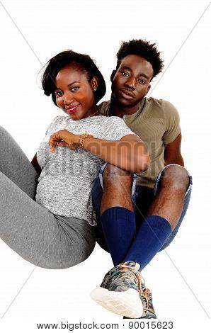 Black Couple Sitting On Floor.