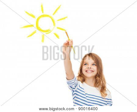 education, school and imaginary screen concept - cute little girl drawing sun with brush