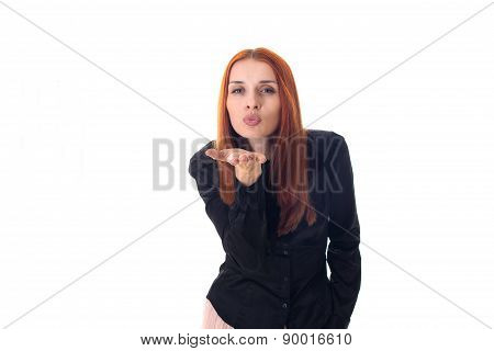 Portrait of a beautiful redhead woman sending a kiss