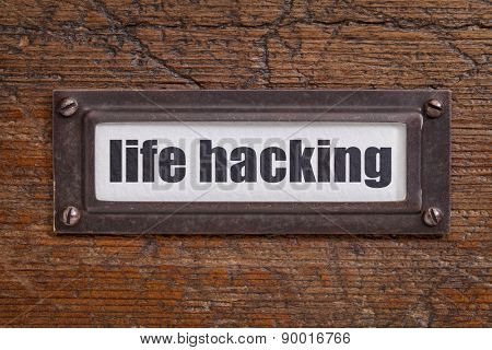 life hacking  tag - file cabinet label, bronze holder against grunge and scratched wood