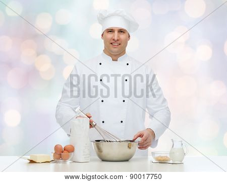 cooking, profession, haute cuisine, food and people concept - happy male chef cook baking over blue lights background