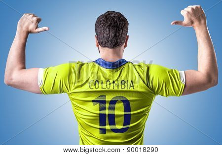 Colombian soccer player on blue background