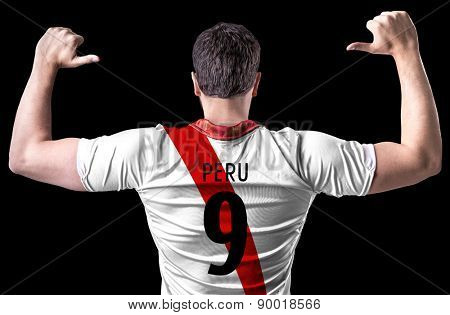 Peruvian soccer player on black background