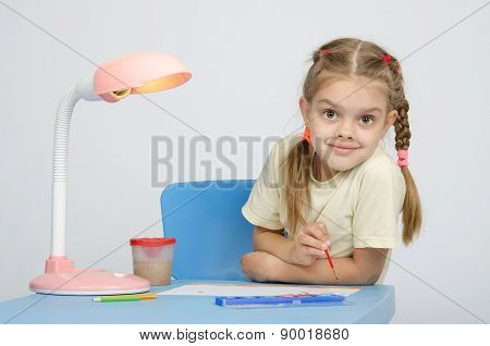 Girl Painting Paints At The Table, Looked Into Frame