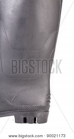 Close up of black rubber boot.