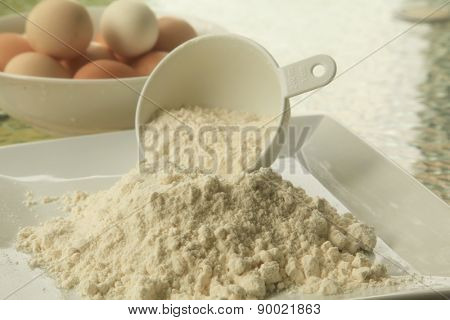 Baking Flour in Outdoor Setting with Eggs