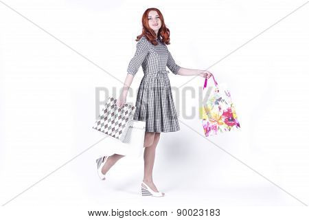 Woman walking with bags from the store