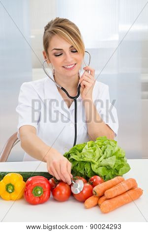 Female Dietician Examining Vegetables