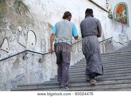 Ukraine, Bakhchisaray - September 06, 2011: Monks Of The Holy Dormition Monastery Going Up The Stair