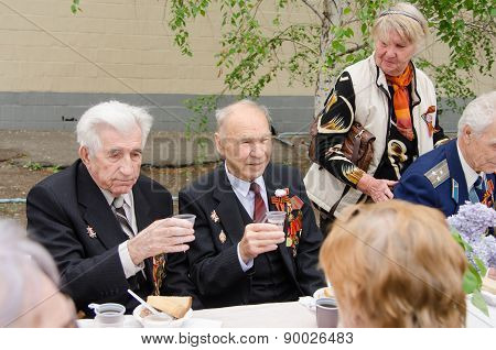 Veterans Sitting At The Festive Table