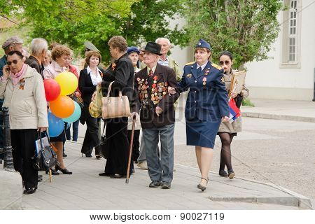Veteran Military Personnel Helping To Pass Through The Crowd At A Gala Event