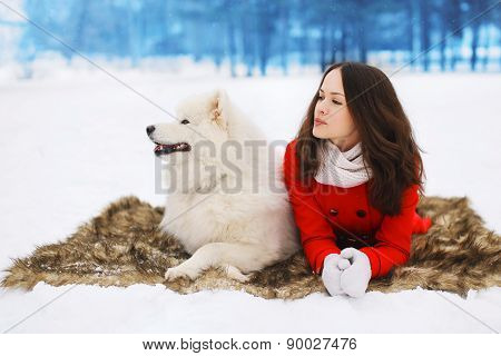 Winter And People Concept - Beautiful Woman With White Samoyed Dog On The Snow In Winter