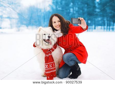 Winter, Christmas, Technology And People Concept - Happy Woman And Dog Having Fun Takes Selfie Portr