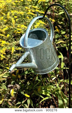 Metal Watering Bucket Hanging In Garden