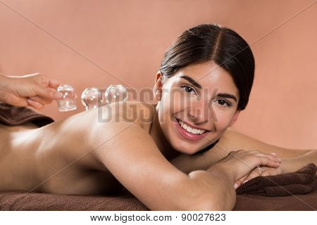 Smiling Woman Receiving Cupping Therapy