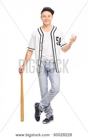 Full length portrait of a young baseball player in a white jersey posing with a bat and a ball isolated on white background