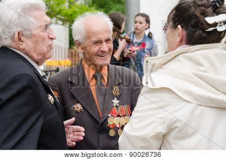 Volgograd, Russia - may 07, 2015: Veterans Communicate With Passers-by At A Gala Event