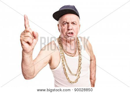 Angry senior with a hip-hop cap and a golden chain around his neck threatening with his finger isolated on white background