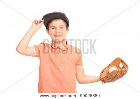 Cheerful little boy with a blue cap holding a baseball and looking at the camera isolated on white background