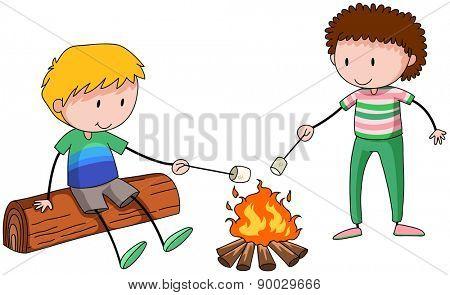 Boys burning mushmellow at the campfire