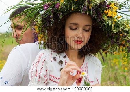 guy and girl on the meadow