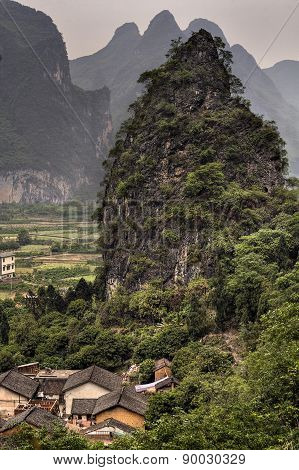 Farmhouse In Peasant Village At Foot Of Karst Hill, China.