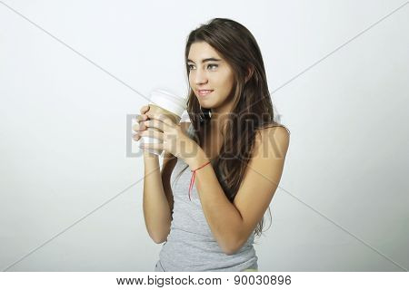 Young woman drinking coffee.