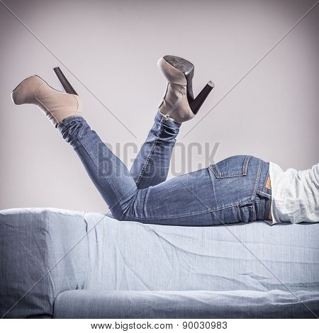 Woman Legs In Denim Trousers High Heels Shoes