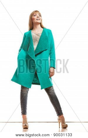 Full Length Fashion Woman In Green Coat.