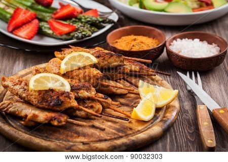 Grilled chicken skewers with lemon marinade and spices