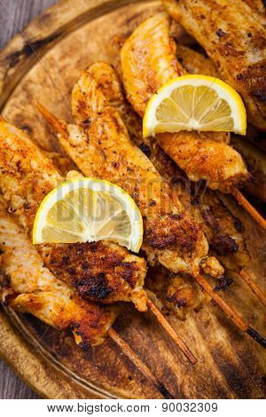 Grilled chicken skewers with lemon marinade