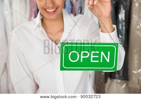 Owner Showing Open Sign