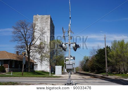 Railroad Crossing Gate with an Old Grain Elevator in the Background