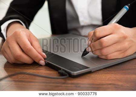 Person Hand Drawing On Graphic Tablet