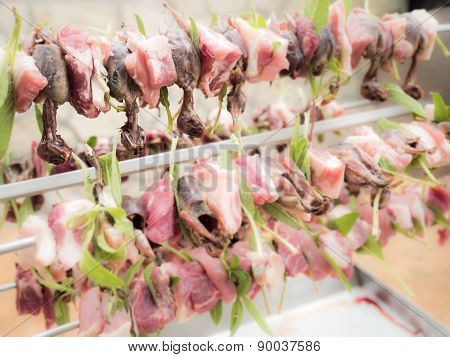 Birds On The Spit With Meat, Bacon And Sage Ready To Be Cooked