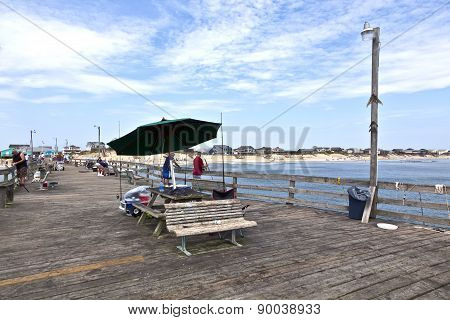People Enjoy Fishing At The Famous Pier