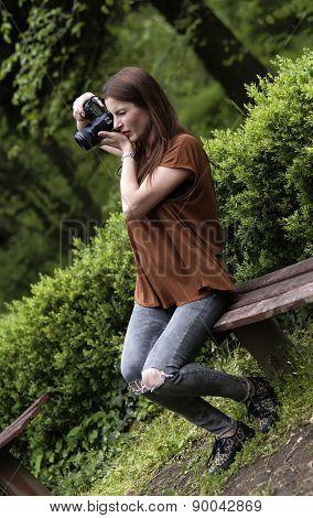 Brunette girl taking nature photos